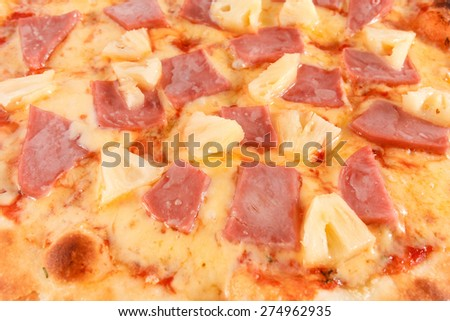 Pizza with ham and pineapple close-up, selective focus, macro