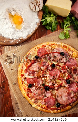 Pizza with Ham and Salami - stock photo