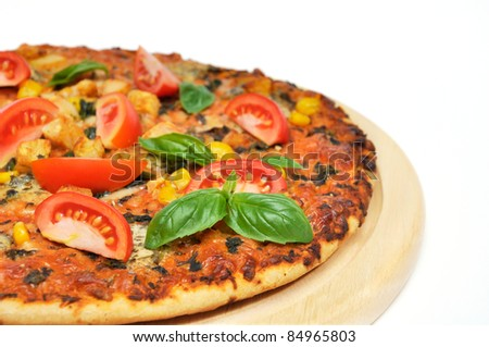 Pizza with ham and tomatoes on white background