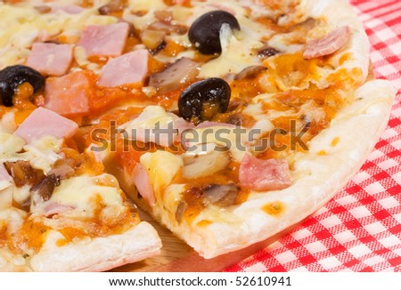 pizza with ham and vegetables as background
