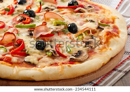 Pizza with ham, mushrooms and olives