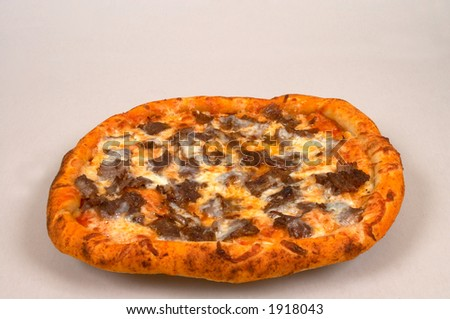 pizza with meat and cheese