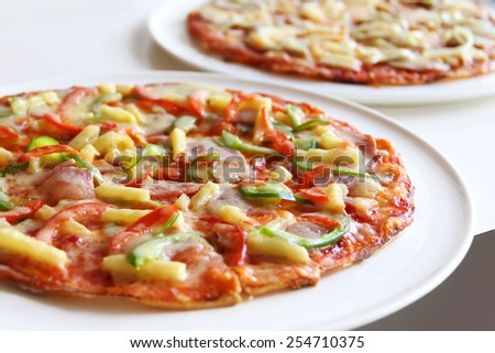 Pizza with Mozzarella Cheese Served at Restaurant Table - stock photo