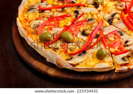 Pizza with Mozzarella, Mushrooms, Olives and Tomato Sauce