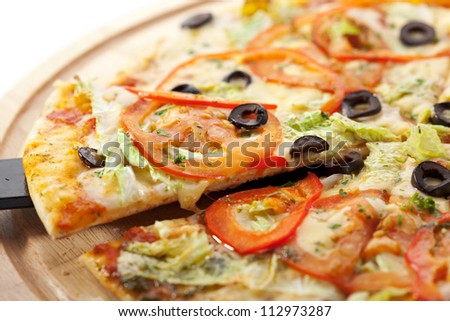 Pizza with Mozzarella, Sauce, Tomatoes and Salad Leaves