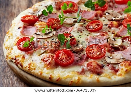 Pizza with mushrooms and ham  - stock photo