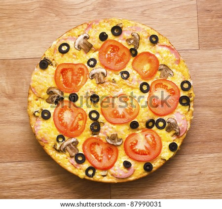 pizza with mushrooms on the table - stock photo