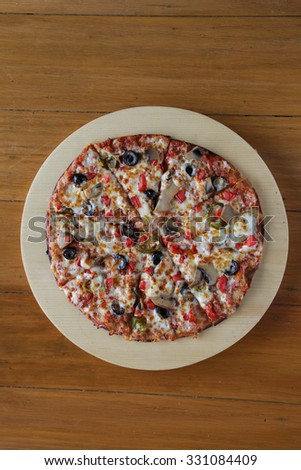 Pizza with olives cheese mushrooms top aerial view  - stock photo