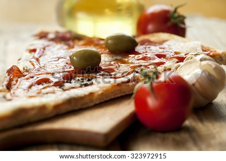 pizza with olives on the table - stock photo