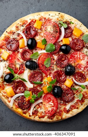 Pizza with pepperoni sausage and vegetables - stock photo