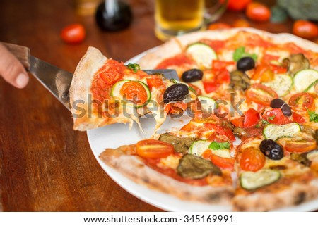 Pizza with peppers, olives and cheese