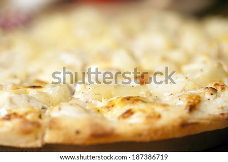 Pizza with pineapple,chicken,sour cream,cheese,oregano
