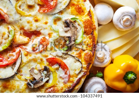 pizza with red tomato, mushrooms and cheese