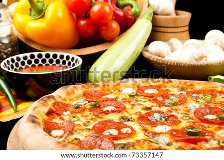 Pizza with salami and blue cheese - stock photo