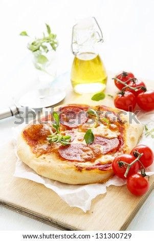 Pizza with salami and oregano