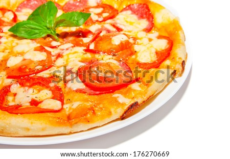 Pizza with salami, cheese and tomato, fast food on plate