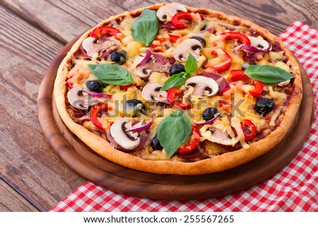 Pizza with salami, mushrooms, mozzarella and basil horizontal - stock photo
