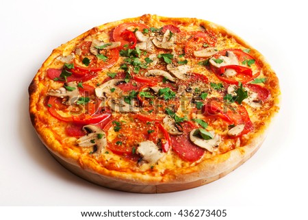 Pizza with salami, tomatoes, paprika and mushrooms isolated on white