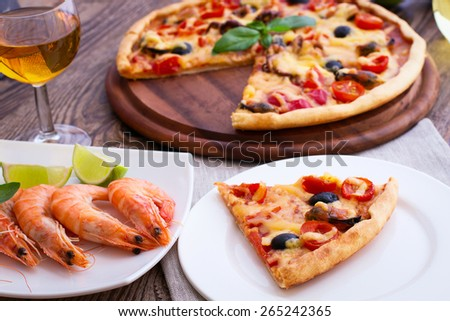 Pizza with seafood on wood table horizontal - stock photo