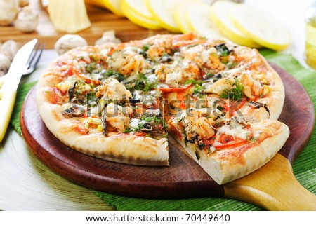 Pizza with the cut of slice - stock photo