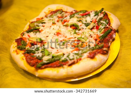 pizza with vegetables, meat and cheese - stock photo