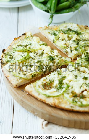 pizza with zucchini and cheese, close up food - stock photo