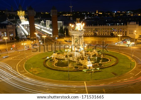 Placa d'Espanya (Plaza de Espana) at night, Barcelona, Spain. This plaza is the largest square of Barcelona, with the Museu Nacional d'Art de Catalunya at the background. - stock photo
