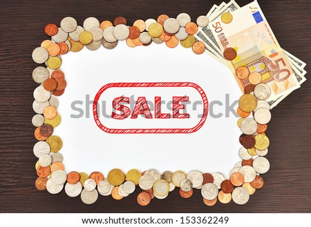 placard with drawing sale and money - stock photo