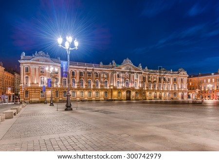 Place du Capitole and Capitole 135 meters long facade built in 1750 of the characteristic pink brick in Neoclassical style in Toulouse, Haute-Garonne, Midi Pyrenees, southern France. - stock photo