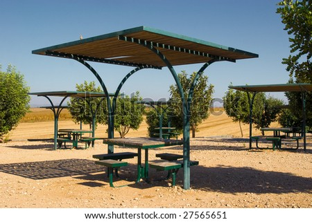 place for camping with roofed tables - stock photo