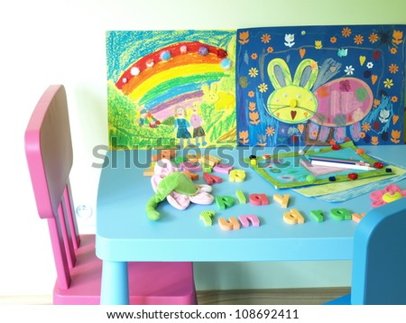 Place for children with colorful toys and paintings - stock photo