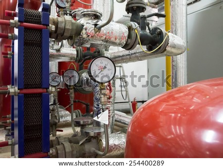 Place in a large industrial boiler room. Parts replaced during repair work - stock photo