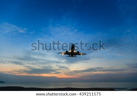 Place is landing at Phuket airport over the Mai Khao beach on sunset at Thailand - stock photo