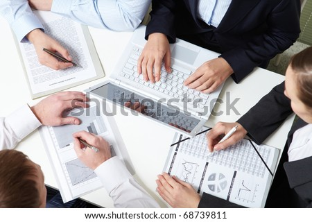 Place of work of four business people - stock photo