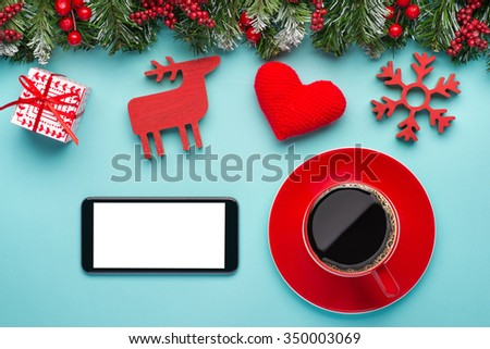 Place on office table with phone, red gifts decoration items and a cup of coffee, concept to christmas gift and holiday season - stock photo