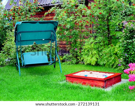 place outdoor with sandbox and seesaw - stock photo
