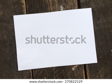 Place paper on wood