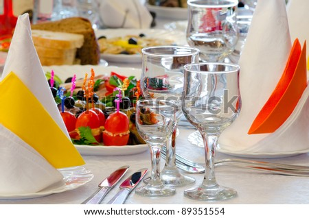place setting at a laid restaurant banquet table