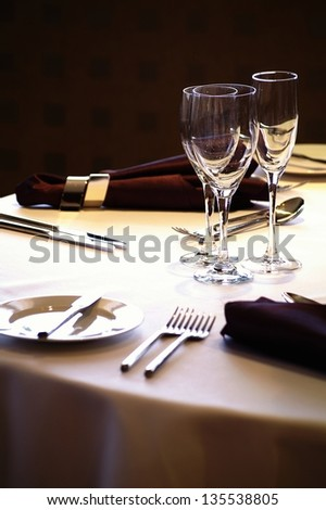 place setting at laid restaurant banquet table - stock photo
