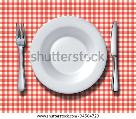 Place setting for a classic family restaurant with a red and white checkered table cloth and a ceramic china plate silver fork and knife as italian food cuisine and traditional american eateries. - stock photo