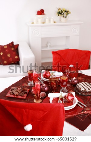 Place setting for Christmas in red and white tone - stock photo