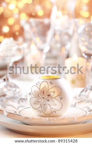 Place setting for Christmas in white and golden tone - stock photo