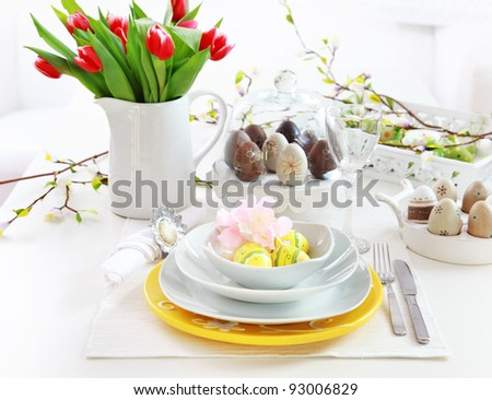 Place setting for Easter with eggs and tulips