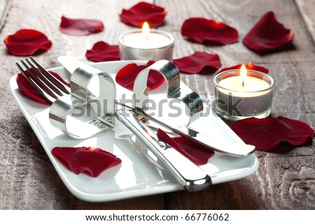 place setting for lovers with rose petals
