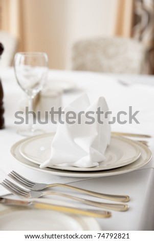 Place setting in an expensive haute cuisine restaurant - stock photo