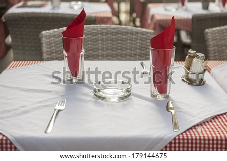 Place setting on dining table without plate in an outdoor restaurant - stock photo
