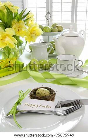 Place setting with card and flowers for easter brunch - stock photo