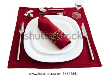 place setting with dark red napkin