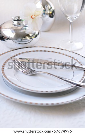 place setting with dinner plate - stock photo