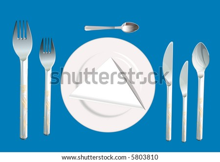 Place setting with plate, fork, spoon and knife. - stock photo